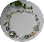 Jasper, rock quartz, pearl, shell and aquamarine with sterling accents create an usual and eye catching necklace.  R08