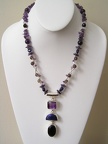"Triple strand of amethyst, lapis and smokey quartz on double strand of smokey quartz and sterling tubes.  TT2023  20"" long"
